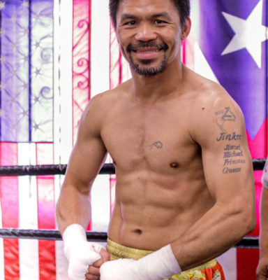 """""""Pacquiao"""" beats """"Ugas"""" to claim the welterweight world championship"""